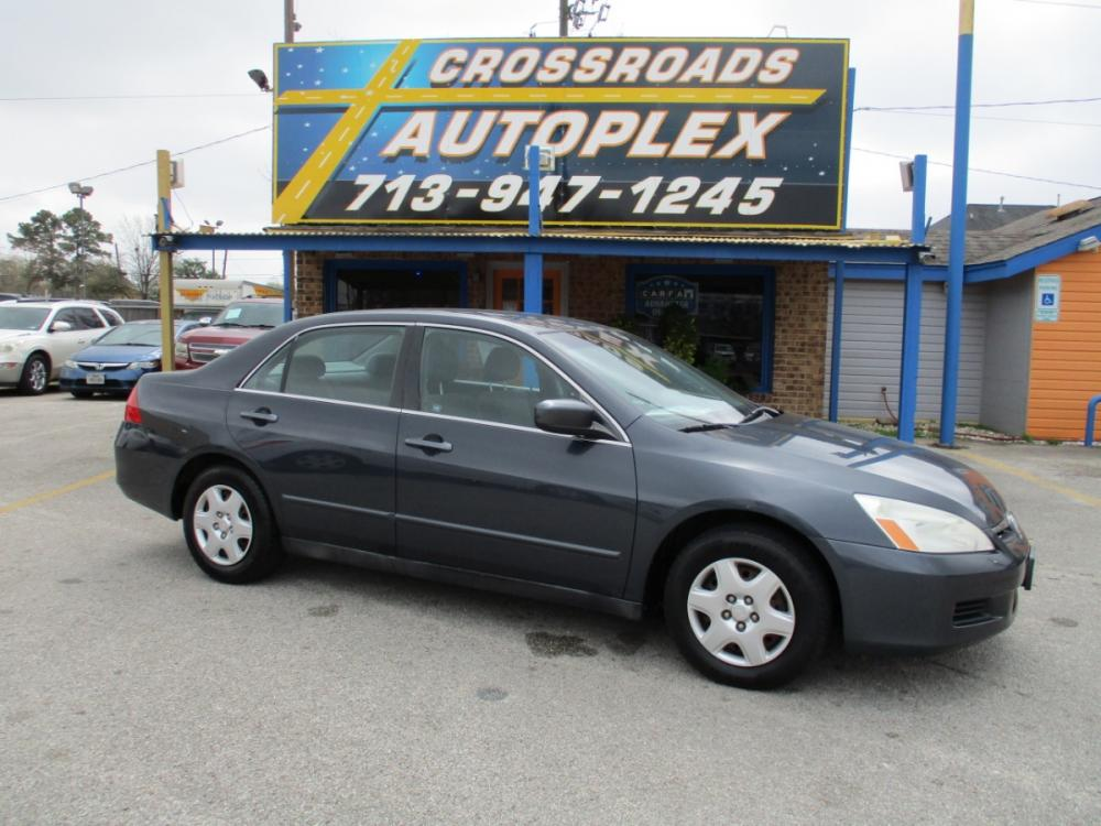 2007 GRAY HONDA ACCORD LX Sedan AT (3HGCM56457G) with an 2.4L L4 DOHC 16V engine, 5-SPEED AUTOMATIC transmission, located at 310 Spencer Hwy, South Houston, TX, 77587, (713) 947-1245, 29.664383, -95.228897 - Photo #0