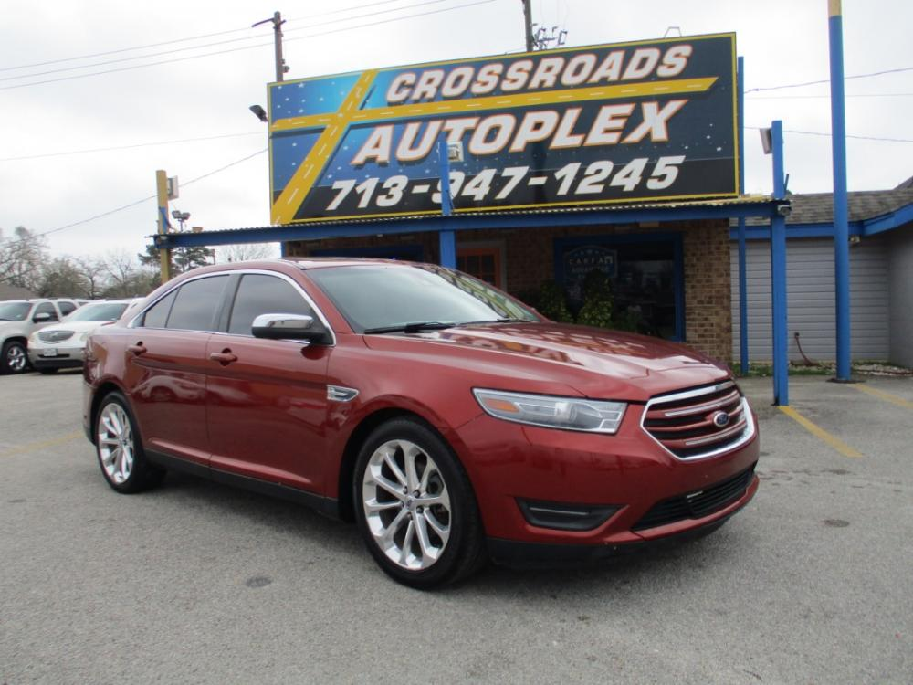 2014 MAROON FORD TAURUS Limited FWD (1FAHP2F86EG) with an 3.5L V6 DOHC 24V engine, 6-SPEED AUTOMATIC transmission, located at 310 Spencer Hwy, South Houston, TX, 77587, (713) 947-1245, 29.664383, -95.228897 - Photo #0