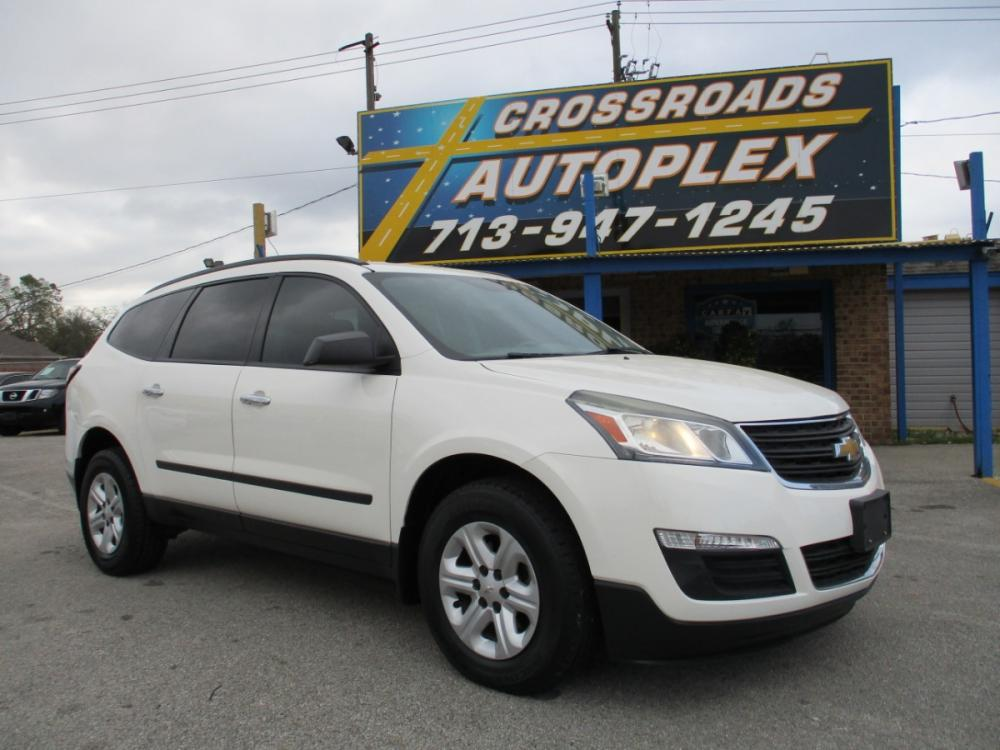 2014 WHITE CHEVROLET TRAVERSE LS FWD w/PDC (1GNKRFEDXEJ) with an 3.6L V6 DOHC 24V engine, 6-SPEED AUTOMATIC transmission, located at 310 Spencer Hwy, South Houston, TX, 77587, (713) 947-1245, 29.664383, -95.228897 - Photo #0
