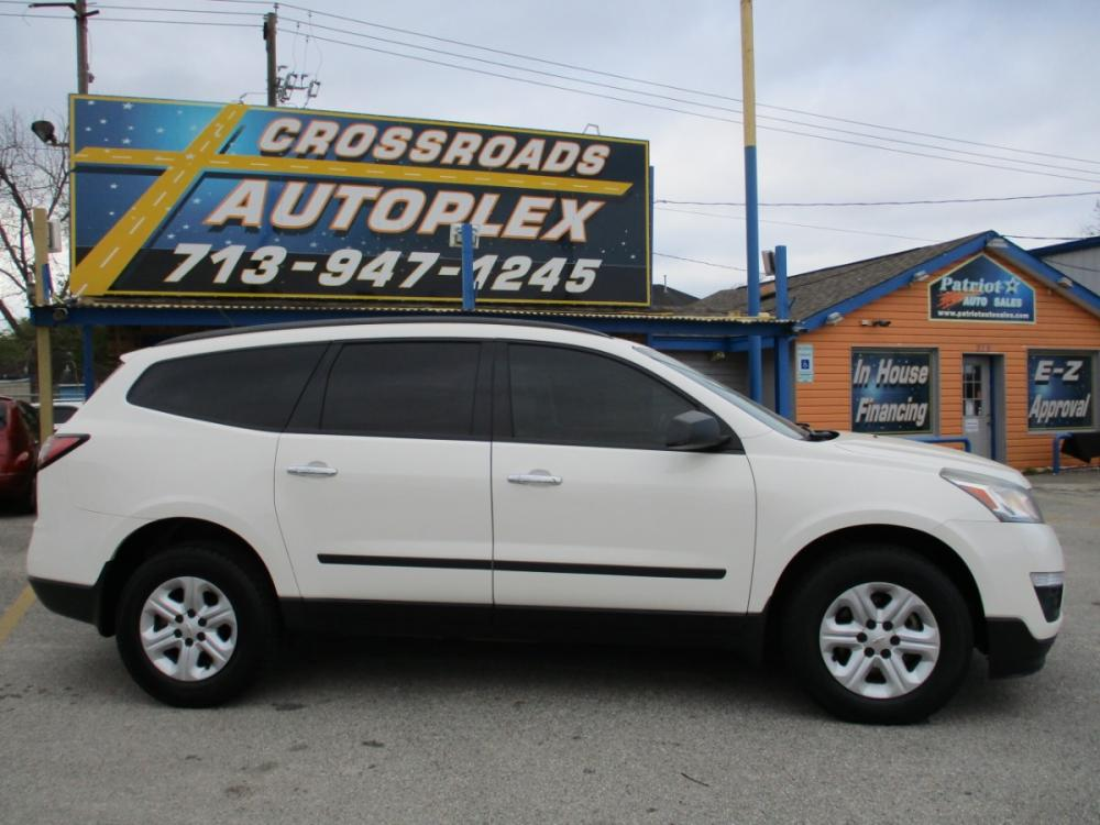 2014 WHITE CHEVROLET TRAVERSE LS FWD w/PDC (1GNKRFEDXEJ) with an 3.6L V6 DOHC 24V engine, 6-SPEED AUTOMATIC transmission, located at 310 Spencer Hwy, South Houston, TX, 77587, (713) 947-1245, 29.664383, -95.228897 - Photo #1