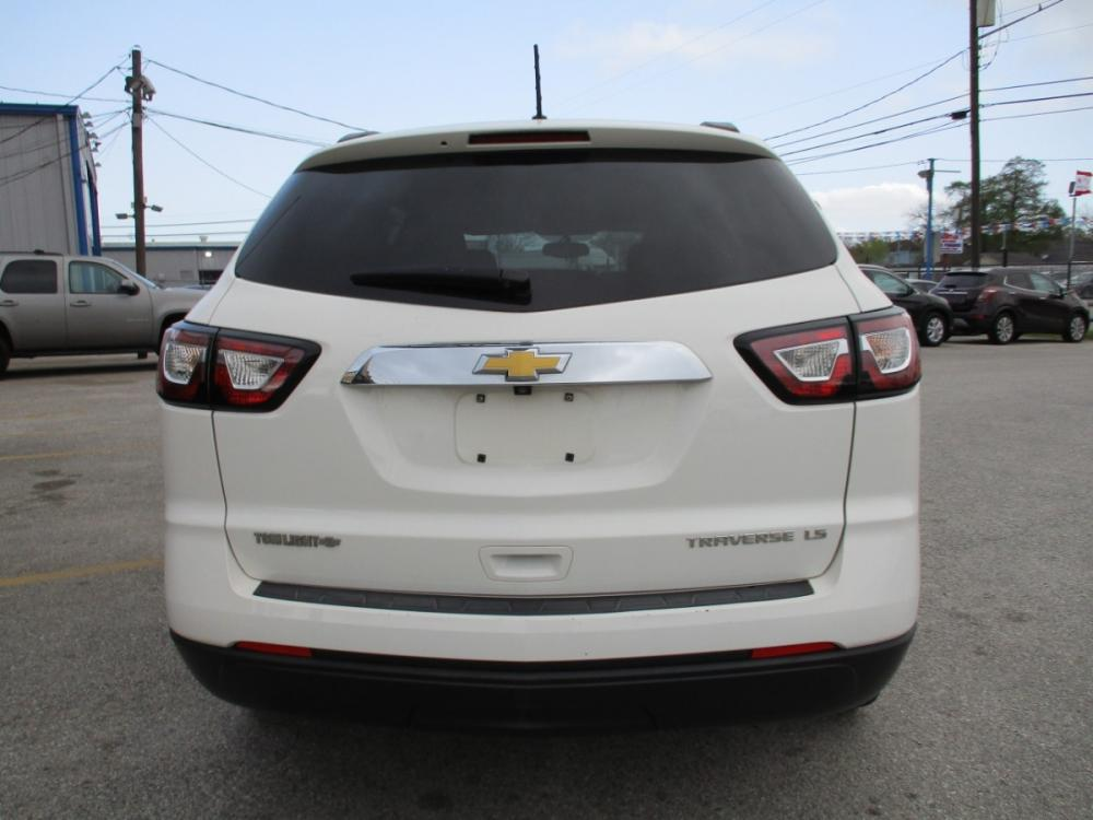 2014 WHITE CHEVROLET TRAVERSE LS FWD w/PDC (1GNKRFEDXEJ) with an 3.6L V6 DOHC 24V engine, 6-SPEED AUTOMATIC transmission, located at 310 Spencer Hwy, South Houston, TX, 77587, (713) 947-1245, 29.664383, -95.228897 - Photo #3